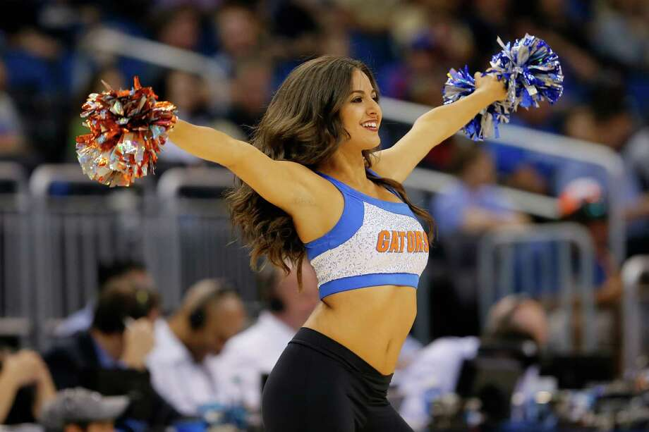 ORLANDO, FL - MARCH 20:  A Florida Gators cheerleader performs in the first half while the Gators take on the Albany Great Danes during the second round of the 2014 NCAA Men's Basketball Tournament at Amway Center on March 20, 2014 in Orlando, Florida. Photo: Kevin C. Cox, Getty Images / 2014 Getty Images