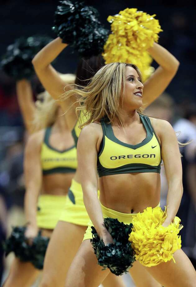 MILWAUKEE, WI - MARCH 20:  Oregon Ducks cheerleaders perform during the second round game of the NCAA Basketball Tournament against the Brigham Young Cougars at BMO Harris Bradley Center on March 20, 2014 in Milwaukee, Wisconsin. Photo: Jonathan Daniel, Getty Images / 2014 Getty Images