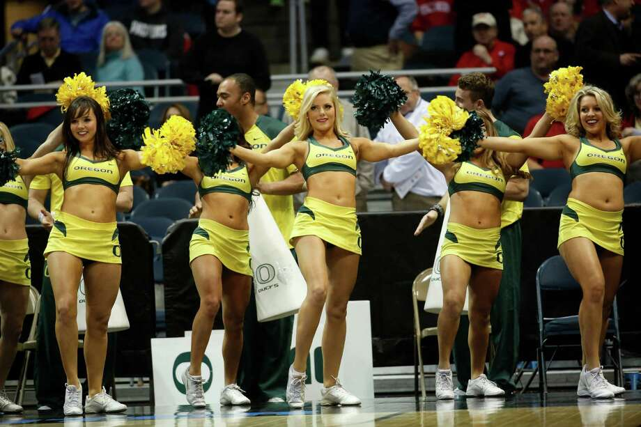 Oregon cheerleaders perform during the first half of a second-round game against the BYU in the NCAA college basketball tournament Thursday, March 20, 2014, in Milwaukee. (AP Photo/Jeffrey Phelps) Photo: Jeffrey Phelps, Associated Press / FR59249 AP