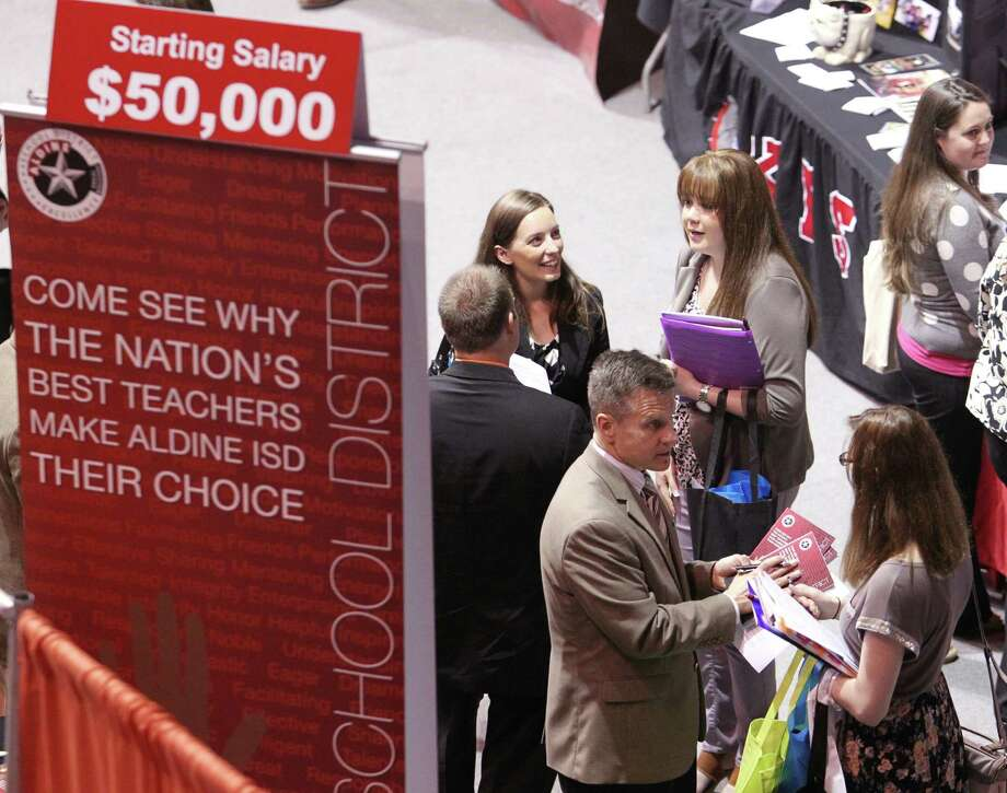 While welcoming prospective teachers The Aldine School District  promotes that they have raised there starting salary for  teachers to $50,000 during a teachers job fair at Sam Houston State University in Huntsville, TX Wednesday March 19, 2014. Photo: Billy Smith II, Chronicle / © 2014 Houston Chronicle