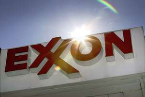 Exxon Mobil has agreed to say how it appraises carbon-intensive assets under stricter climate rules.