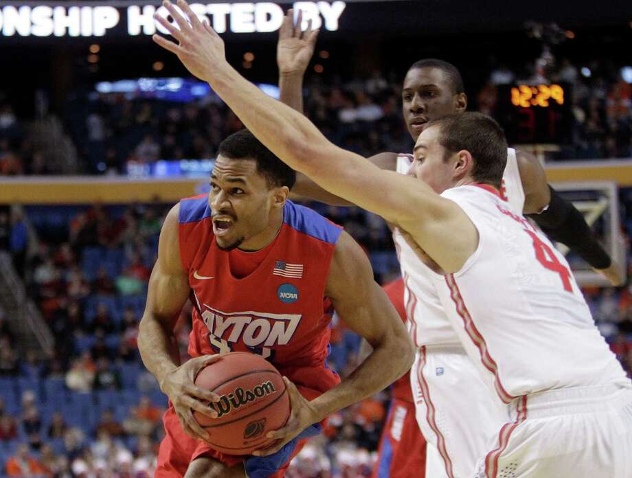Dayton's Vee Sanford (43) drives past Ohio State's Aaron Craft (4) during the first half of a second-round game in the NCAA college basketball tournament Thursday, March 20, 2014, in Buffalo, N.Y.  (AP Photo/Bill Wippert) ORG XMIT: NYFF110 Photo: Bill Wippert / FR170745 AP