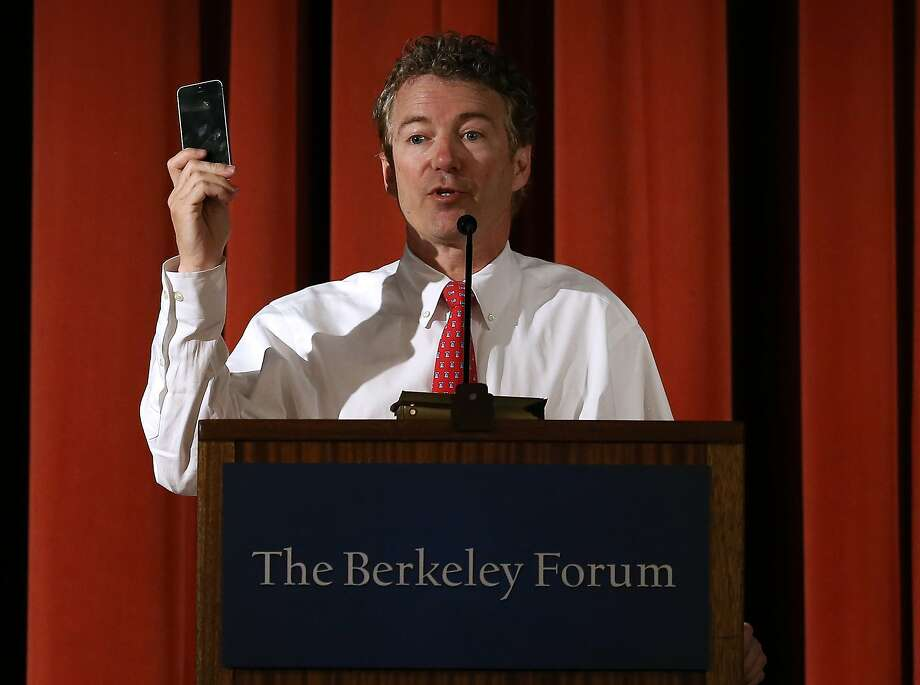 Sen. Rand Paul, R-Ky., holds up a cell phone to emphasize a point about government intrusions on Americans' privacy. Photo: Justin Sullivan, Getty Images
