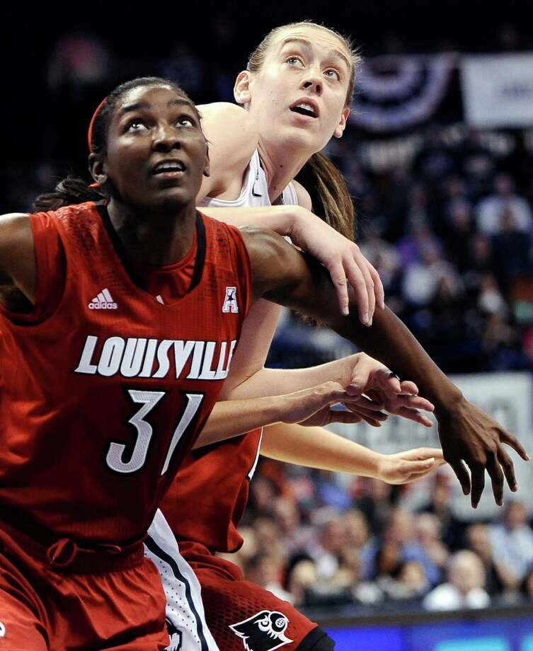 Connecticut's Breanna Stewart, right, and Louisville's Asia Taylor, left, look for a rebound during the second half of an NCAA college basketball game in the finals of the American Athletic Conference women's basketball tournament, Monday, March 10, 2014, in Uncasville, Conn. Connecticut won 72-52. (AP Photo/Jessica Hill) Photo: Jessica Hill, Associated Press / Associated Press