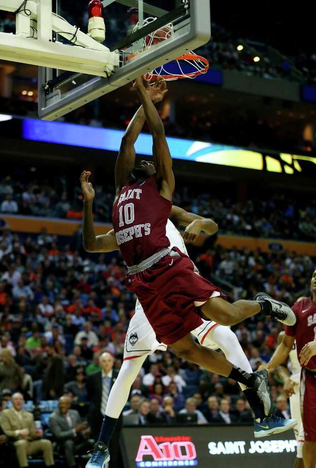 BUFFALO, NY - MARCH 20: Langston Galloway #10 of the Saint Joseph's Hawks goes to the basket against Phillip Nolan #0 of the Connecticut Huskies during the second round of the 2014 NCAA Men's Basketball Tournament at the First Niagara Center on March 20, 2014 in Buffalo, New York. Photo: Elsa, Getty Images / 2014 Getty Images