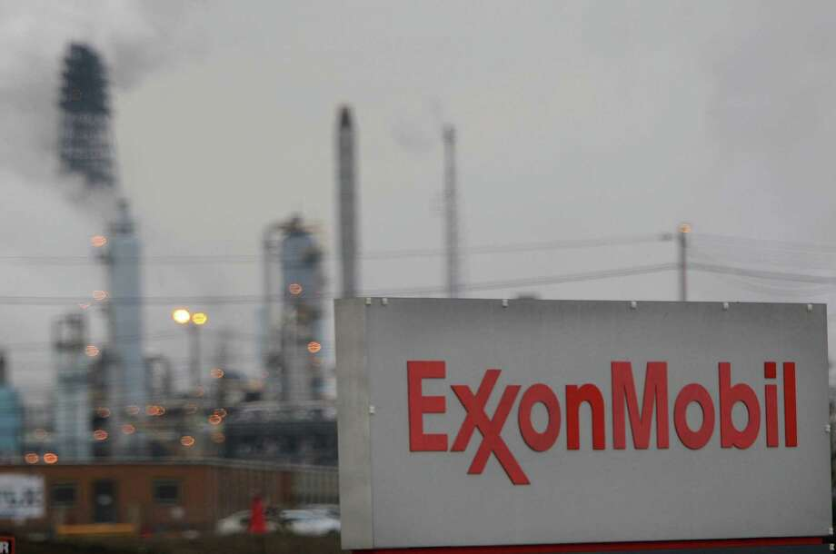 Exxon Mobil has agreed to tell investors how it appraises carbon-intensive assets such as oil sands under increasingly strict climate rules. Photo: Houston Chronicle