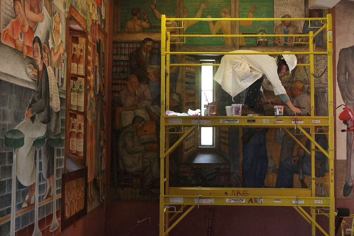 Beate Bruhl works on restoring a back wall of the mural at Coit Tower March 20, 2014 in San Francisco, Calif. Officials hope to have the tower back open by mid to late April after completing the first restorations on its internal structure and mural since 1989.