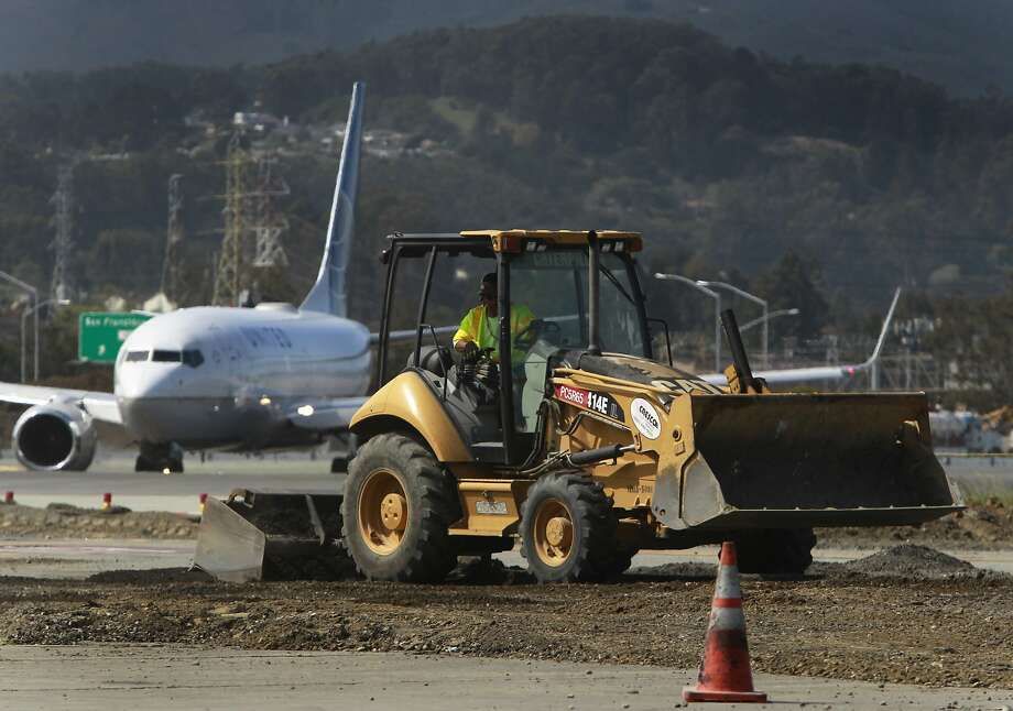 Preliminary construction work has begun near the runways at San Francisco International Airport. Photo: Paul Chinn, The Chronicle