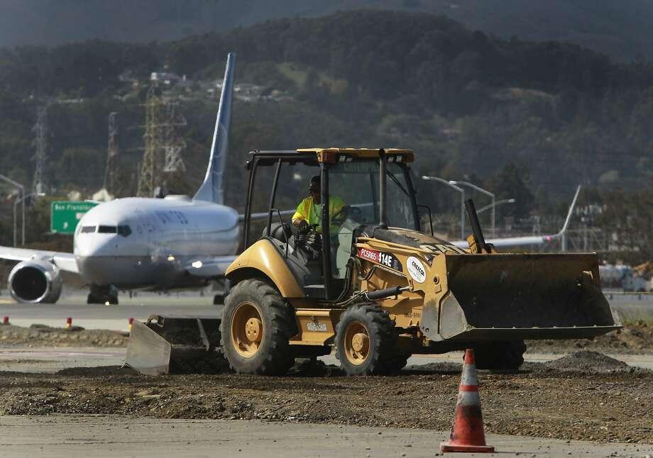 Preliminary construction work has begun near the runways at San Francisco International Airport. Photo: Paul Chinn, The Chronicle