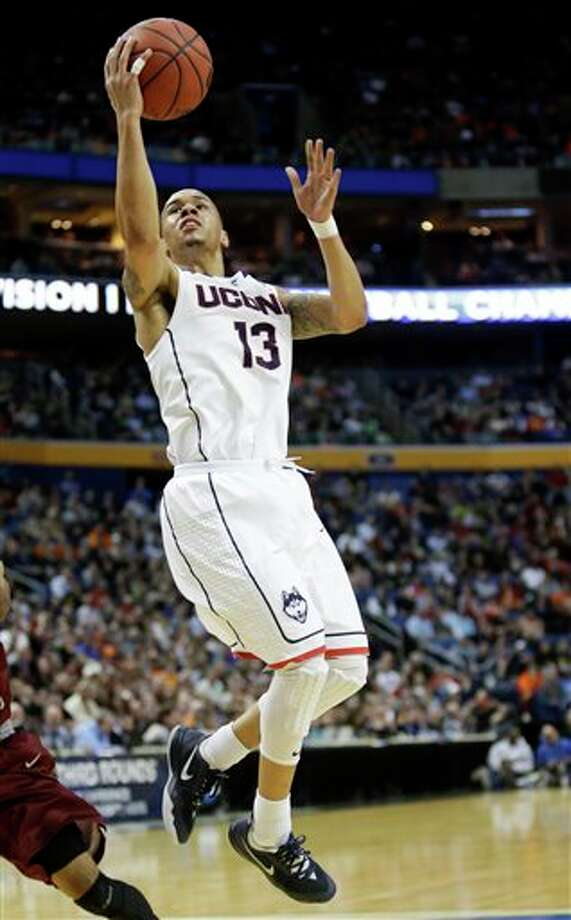Connecticut's Shabazz Napier  drives to the basket during the second half of a second-round game  against Saint Joseph's in the NCAA college basketball tournament in  Buffalo, N.Y., Thursday, March 20, 2014. (AP Photo/Nick LoVerde)