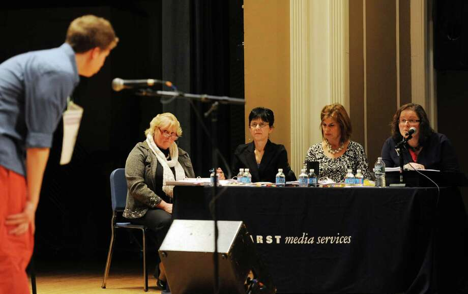 Matthew Carlucci, of Sherman, spells a word as, from left, recorder Melinda Kelly, judge Donna Christopher, judge Cathy Westervelt, and pronouncer Helen Bechard listen at the Hearst Media Services Regional Spelling Bee at Western Connecticut State University in Danbury, Conn. Thursday, March 20, 2014. Photo: Tyler Sizemore / The News-Times