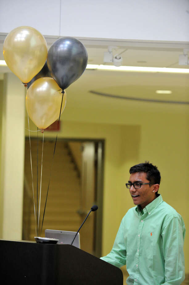 Student Chandu Goli gives the welcoming and introductions during Project Lead the Way's White Coat and Certification Ceremony at the Academy of Information Technology and Engineering in Stamford, Conn., on Thursday, March 20, 2014. Photo: Jason Rearick / Stamford Advocate