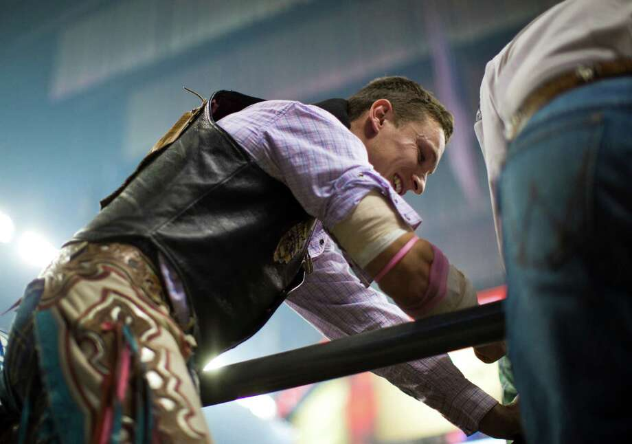 Yvan Jayne, 32, a bareback rider from the south of France, currently residing in Dallas, prepares the horse he will be riding for the BP Super Series Semifinal 1 at the RodeoHouston, Wednesday, March 19, 2014, in Houston. Jayne placed eighth on the Semifinal 1. ( Marie D. De Jeséºs / Houston Chronicle ) Photo: Marie D. De Jeséºs, Staff / © 2014 Houston Chronicle