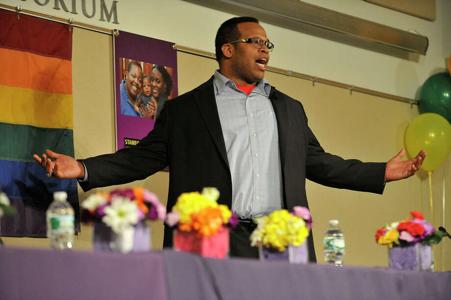 Former athlete and LGBT advocate Akil Patterson gives the keynoe address during the Stamford Coalition for Respect's Coming Out to Open Arms! event at the UConn Stamford Campus in Stamford, Conn., on Thursday, march 20, 2014. Photo: Jason Rearick / Stamford Advocate