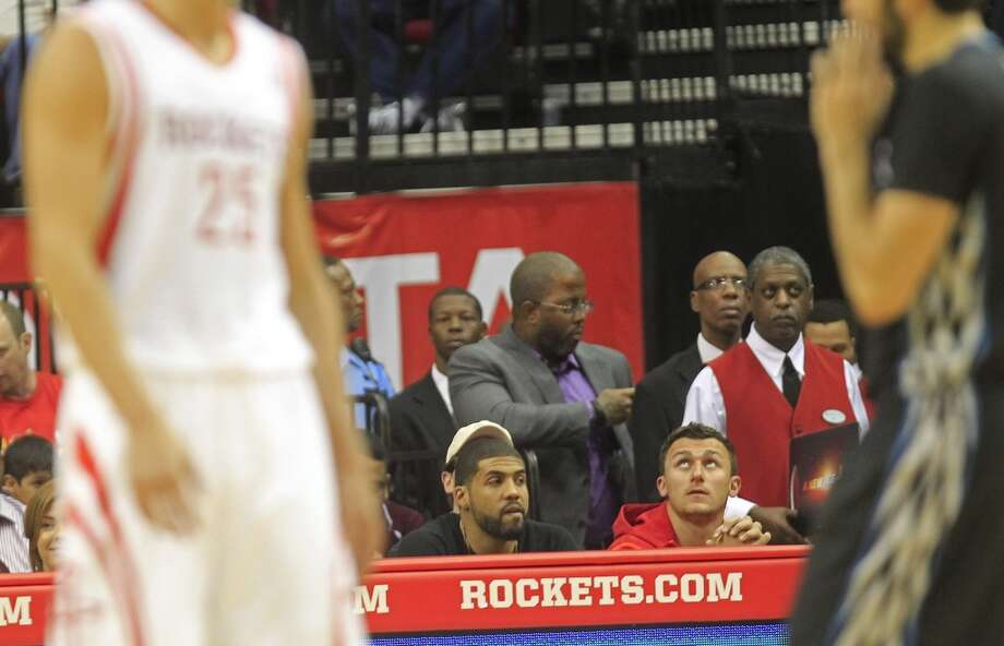 Texans running back Arian Foster takes in the Rockets-Timberwolves game with former Texas A&M quarterback Johnny Manziel. Photo: Johnny Hanson, Houston Chronicle
