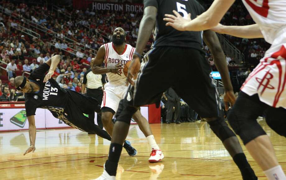 Rockets shooting guard James Harden collides with Corey Brewer of the Timberwolves. Photo: Johnny Hanson, Houston Chronicle