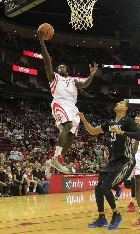 Rockets point guard Pat Beverley drives to the basket against the Timberwolves. Photo: Johnny Hanson, Houston Chronicle