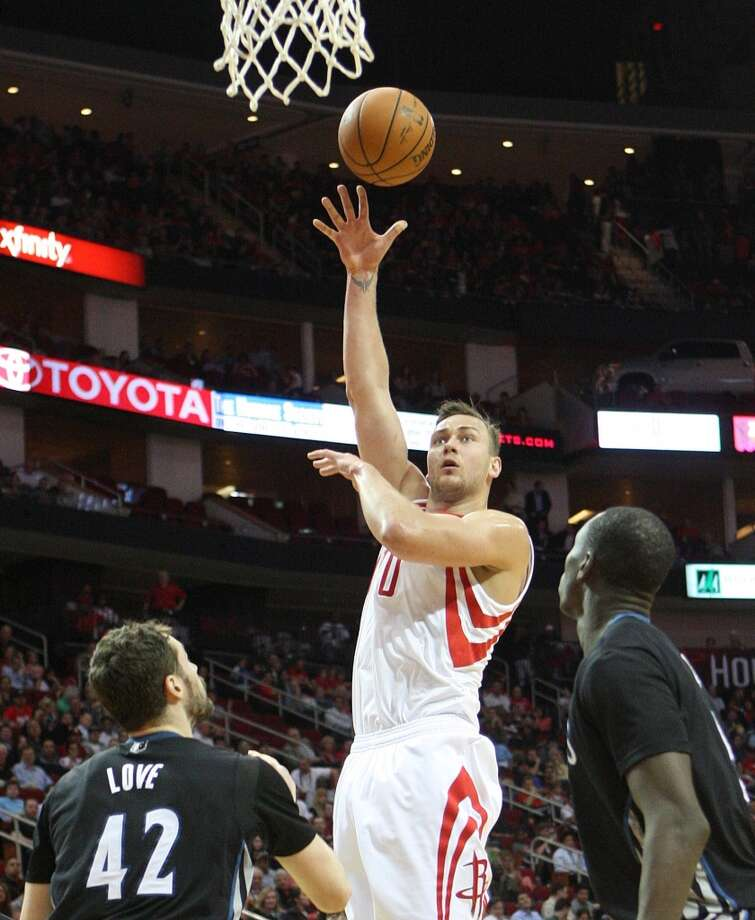 Rockets forward Donatas Motiejunas attempts a hook shot against the Timberwolves. Photo: Johnny Hanson, Houston Chronicle