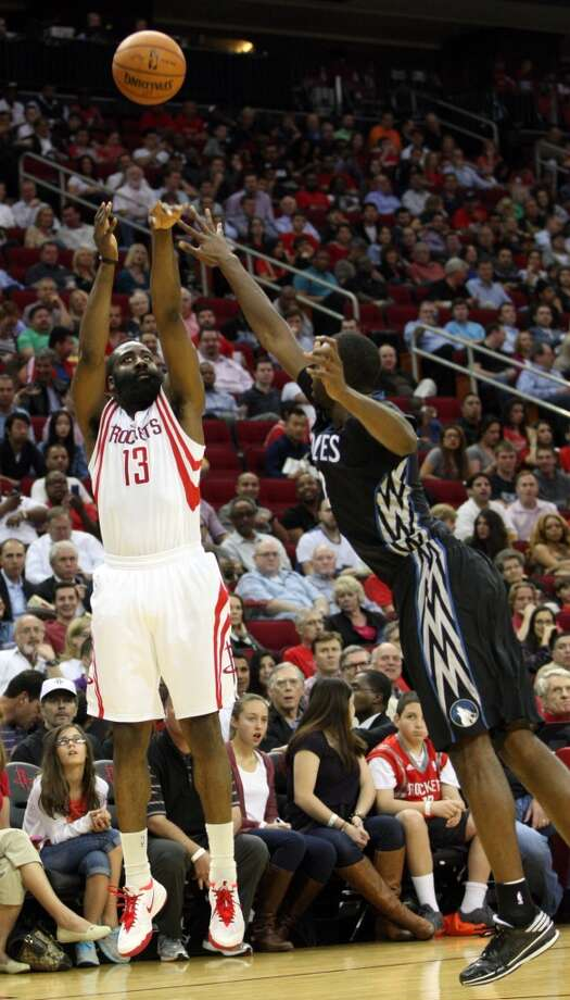 Rockets shooting guard James Harden attempts a shot against the Timberwolves. Photo: Johnny Hanson, Houston Chronicle