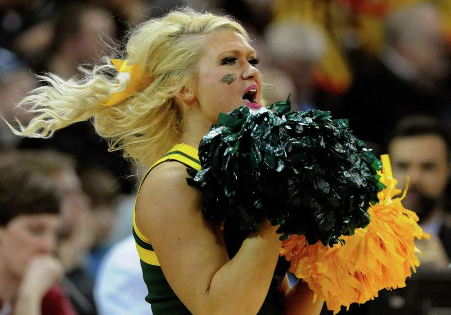 SPOKANE, WA - MARCH 20: A North Dakota State Bison cheerleader performs during the game between the Oklahoma Sooners and the North Dakota State Bison during the second round of the 2014 NCAA Men's Basketball Tournament at Spokane Veterans Memorial Arena on March 20, 2014 in Spokane, Washington. Photo: Steve Dykes, Getty Images / 2014 Getty Images