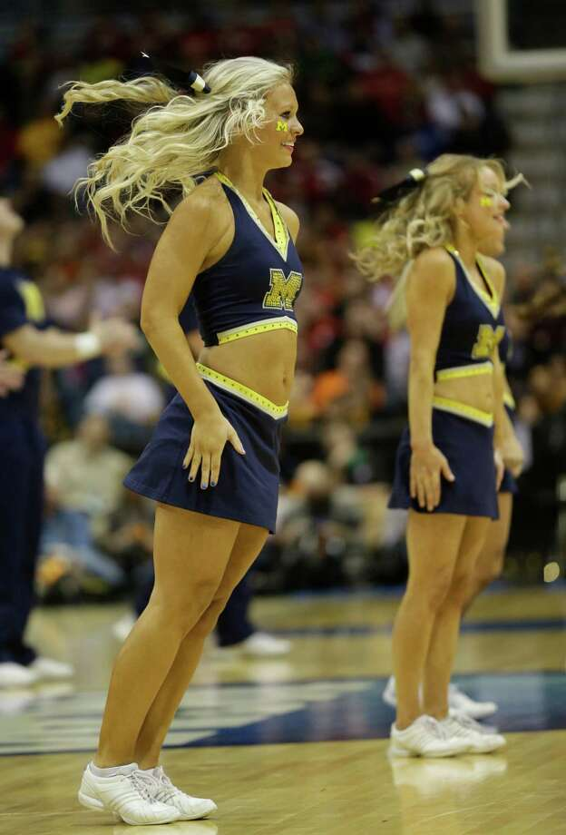 Michigan cheerleaders perform during the second half of a second round NCAA college basketball tournament game between the Michigan and the Wofford Thursday, March 20, 2014, in Milwaukee. (AP Photo/Morry Gash) Photo: Morry Gash, Associated Press / AP