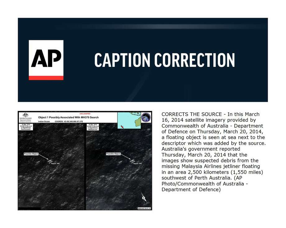 CORRECTS THE SOURCE - In this March 16, 2014 satellite imagery provided by Commonwealth of Australia - Department of Defence on Thursday, March 20, 2014, a floating object is seen at sea next to the descriptor which was added by the source. Australia's government reported Thursday, March 20, 2014 that the images show suspected debris from the missing Malaysia Airlines jetliner floating in an area 2,500 kilometers (1,550 miles) southwest of Perth Australia. (AP Photo/Commonwealth of Australia - Department of Defence) ORG XMIT: SYD105 / Commonwealth of Australia - Department of Defence