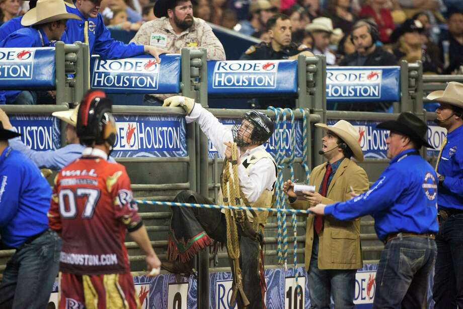 Joe Frost returns to the chute after competing in the BP Super Series Semifinal 2 Bull Riding event during Houston Livestock Show and Rodeo at Reliant Stadium on Thursday, March 20, 2014, in Houston. Photo: Marie D. De Jesus, Houston Chronicle / © 2014 Houston Chronicle