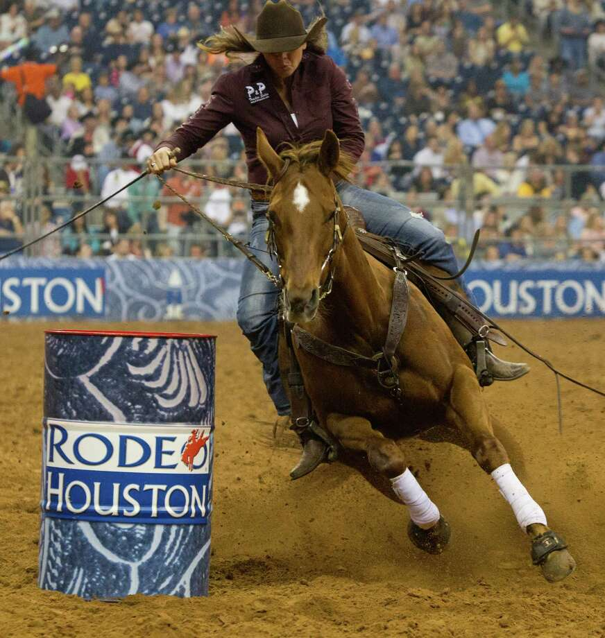 Kelli Thouvenell competes in the BP Super Series Semifinal 2 Barrel Racing competition during Houston Livestock Show and Rodeo at Reliant Stadium on Thursday, March 20, 2014, in Houston. Photo: Marie D. De Jesus, Houston Chronicle / © 2014 Houston Chronicle