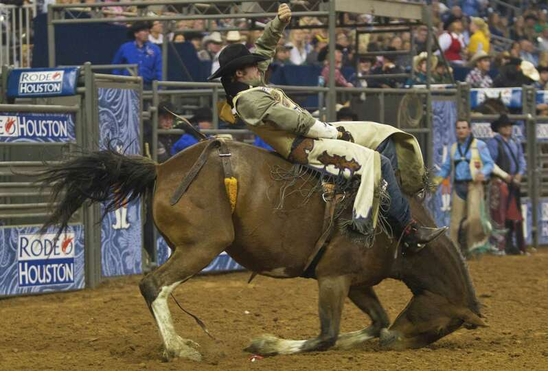 Austin Foss' horse goes on his knees during the BP Super Series Semifinal 2 at the RodeoHouston, Thu