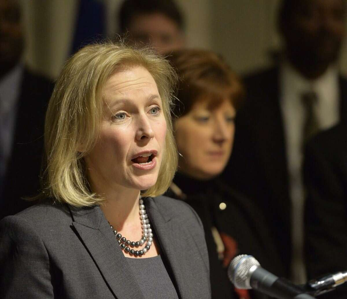 Sen. Kirsten Gillibrand is joined by Albany Mayor Kathy Sheehan in announcing federal legislation to create paid family leave Friday morning, Jan. 10. 2014, at City Hall in Albany, N.Y. (Skip Dickstein/Times Union archive)