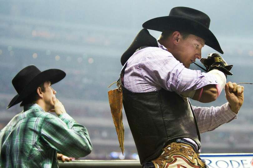 Yvan Jayne, 32, a bareback rider from the south of France, currently residing in Dallas, prepares hi