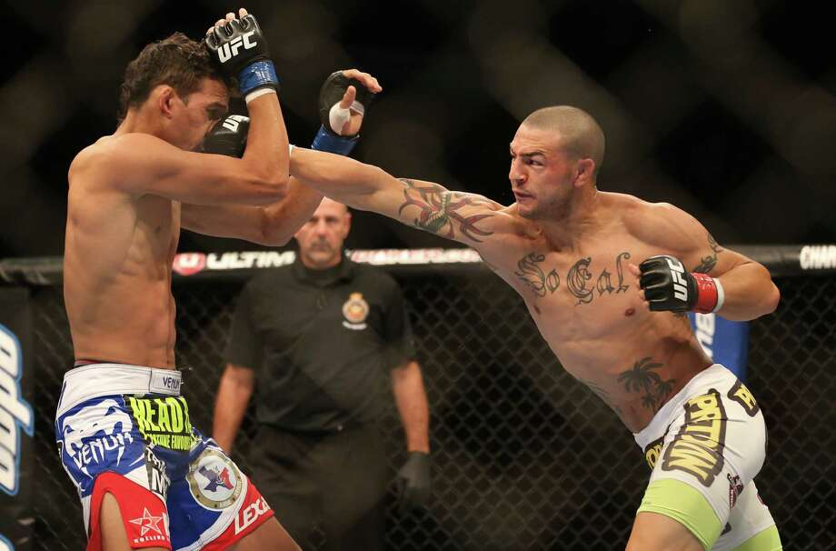 Cub Swanson (right) connects with Charles Oliveira en route to a KO in September. Swanson will fight in the main event at the UFC Fight Night on June 28 at the AT&T Center. Photo: Rene Johnston / Toronto Star / 2012 Toronto Star