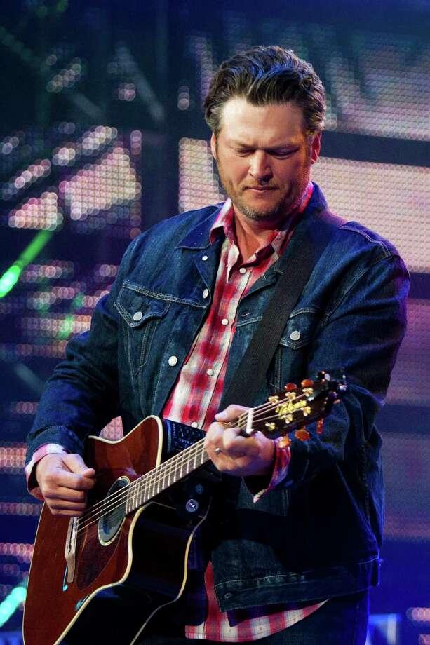 Blake Shelton performs at Reliant Stadium during the Houston Livestock Show and Rodeo, Thursday, March 20, 2014, in Houston. Photo: Marie D. De Jesus, Houston Chronicle / © 2014 Houston Chronicle