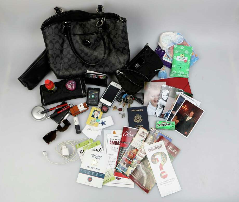 Cassandra Matej's shows what's in her bag. Photo: Helen L. Montoya, San Antonio Express-News / ©2013 San Antonio Express-News