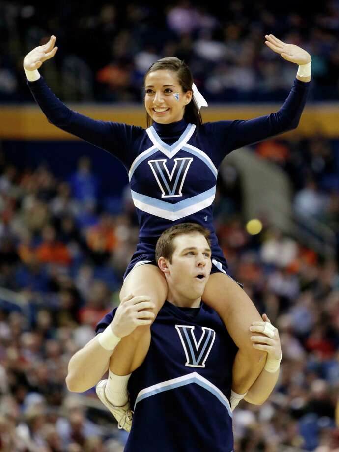 Villanova cheerleaders perform during first half of a second-round game against Milwaukee in the NCAA college basketball tournament in Buffalo, N.Y., Thursday, March 20, 2014. (AP Photo/Nick LoVerde) Photo: Nick LoVerde, Associated Press / FR1171125 AP