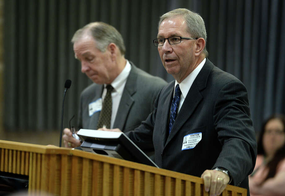 The Texas Education Agency's appointed monitor Fred Shafer addresses the Beaumont Independent School Board Thursday night. Shafer will be paid $600 per day or $75 an hour to monitor the District's special education program. TEA's Ronald Rowell is also pictured.