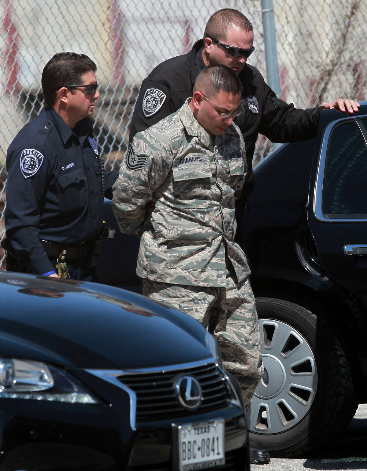 Bexar County Sheriff's deputies escort Air Force Tech. Sgt. Alex Omar Granados, charged with aggravated sexual assault that authorities say took place in June 2013.