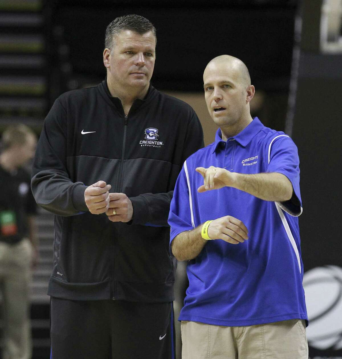 Creighton coach Greg McDermott (left) chats with assistant Steve Lutz, an East Central grad who played at Texas Lutheran.