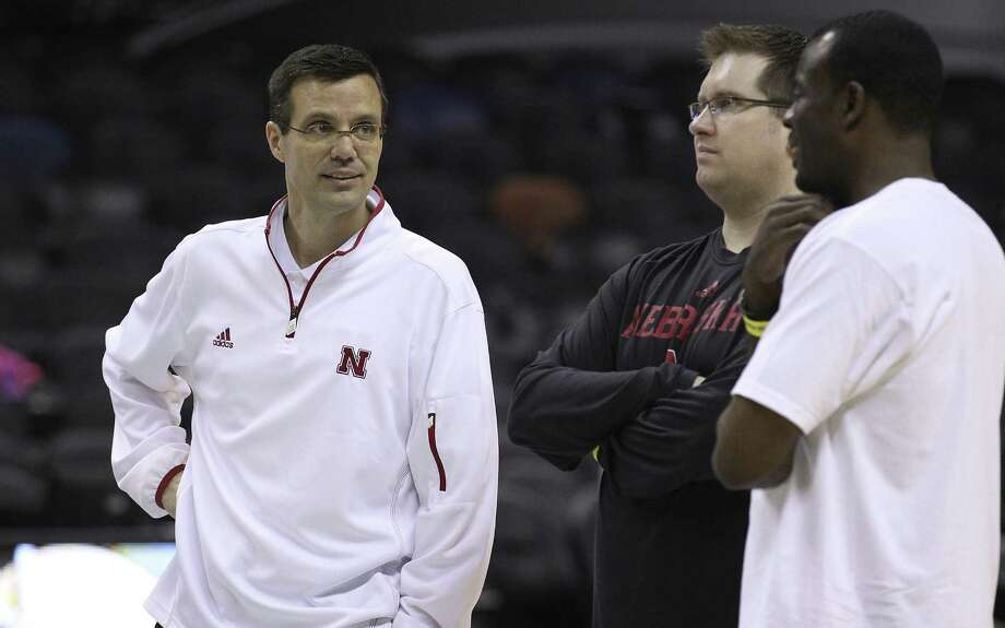 Nebraska coach Tim Miles (left) chats with his staff during the team's practice session at the AT&T Center on Thursday. Photo: Kin Man Hui, San Antonio Express-News / ©2013 San Antonio Express-News