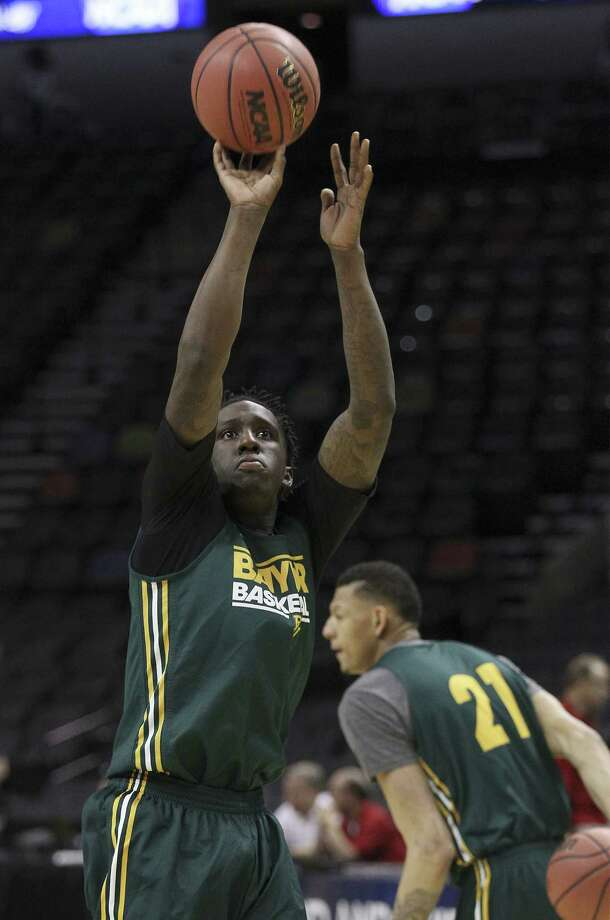 Warren graduate and Baylor forward Taurean Prince takes a shot during practice at the AT&T Center on Thursday. The Bears will face Nebraska today in a matchup of former Big 12 foes in the second round of the NCAA tournament. Photo: Kin Man Hui, San Antonio Express-News / ©2013 San Antonio Express-News