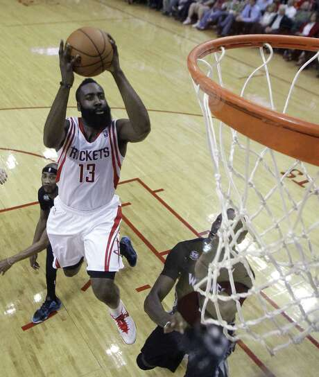 James Harden, who scored 28 points, soars for a shot in the lane during the first half of the Rockets' win over the Timberwolves on Thursday in Houston. Photo: Patric Schneider / Associated Press / FR170473 AP