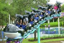 Kids ride on the Shamu Express rollercoaster at SeaWorld