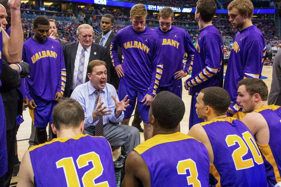 UAlbany Great Danes head coach Will Brown instructs his team at a timeout early in the second half of the NCAA second round game against the Florida Gators, Thurday  afternoon, March 20, 2014, in Orlando, FLA. (Gregory Fisher/Special to the Times Union) Photo: GF / SportsThroughTheLens.com