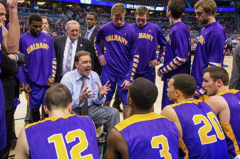 UAlbany Great Danes head coach Will Brown instructs his team at a timeout early in the second half o