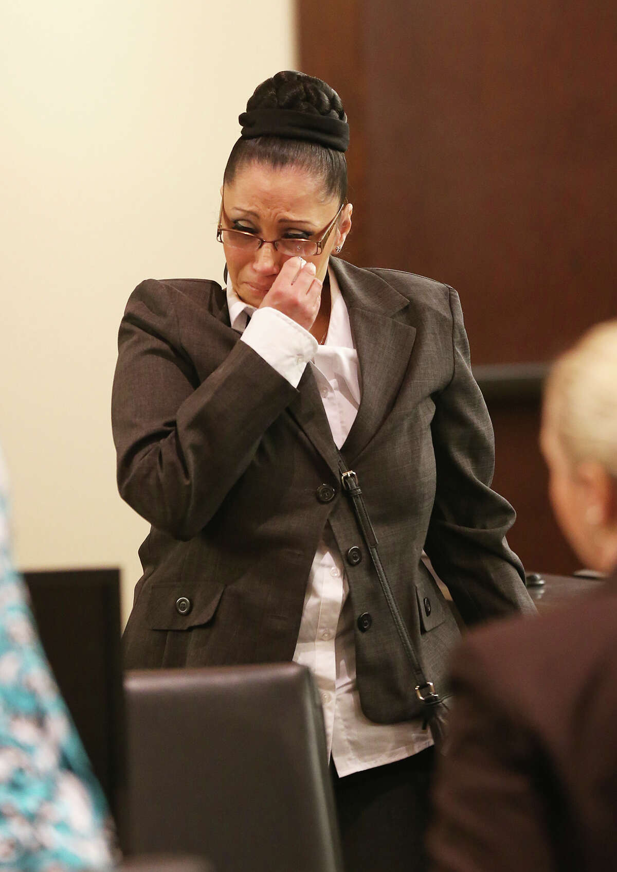 The victim's daughter, Margie Cantu, of Houston, wipes her tears after testifying at the sentencing of Benito Cavazos Valverde, 64, Thursday, March 20, 2014. Bexar County 290th District Court Judge Melisa Skinner sentenced Valverde to 30 years. In February, he was convicted of murdering David Deleon Ramirez, 61, during a bar shooting in 2011.