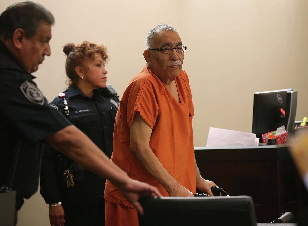 Benito Cavazos Valverde, 64, is escorted into the Bexar County 290th District Court for his sentencing hearing, Thursday, March 20, 2014. In February, Valverde was convicted of murdering David Deleon Ramirez, 61, during a bar shooting in 2011. Judge Melisa Skinner sentenced Valverde to 30 years in prison.