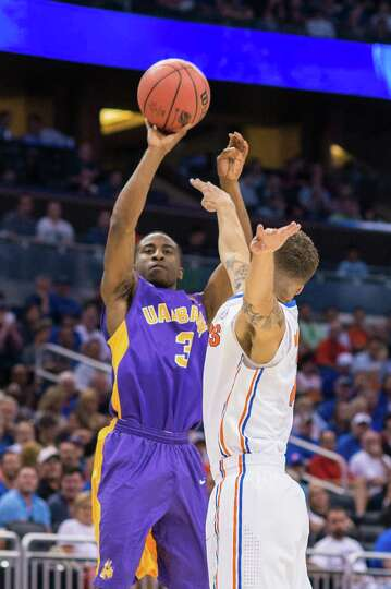 UAlbany Great Danes guard DJ Evans (3) puts up a shot against the Florida Gators during the 1st half