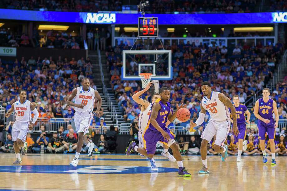UAlbany Great Danes guard DJ Evans (3) get out in front on the fast break with Florida Gators guard Michael Frazier II (20), Florida Gators forward Dorian Finney-Smith (10), Florida Gators forward Chris Walker (23), UAlbany Great Danes forward Luke Devlin (11) and UAlbany Great Danes center John Puk (44) during the 1st half of the  NCAA second round game, Thurday afternoon, March 20, 2014, in Orlando, FLA. (Gregory Fisher/Special to the Times Union) Photo: GF / SportsThroughTheLens.com