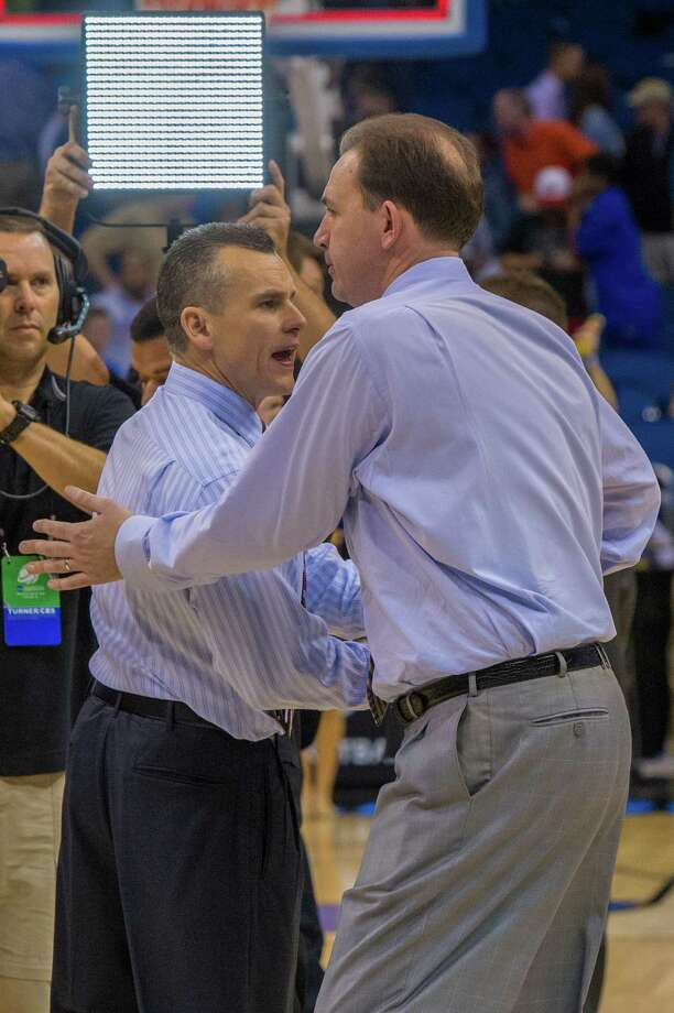 UAlbany Great Danes head coach Will Brown congratulates Florida Gators head coach Billy Donovan after the NCAA second round game, Thurday afternoon, March 20, 2014, in Orlando, FLA. (Gregory Fisher/Special to the Times Union) Photo: GF / SportsThroughTheLens.com