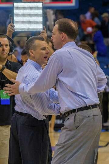 UAlbany Great Danes head coach Will Brown congratulates Florida Gators head coach Billy Donovan afte